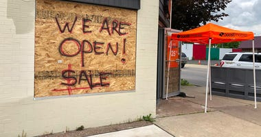 Boost Mobile on Pine Avenue in Niagara Falls is open despite plywood on its windows. June 11, 2020 (WBEN Photo/Mike Baggerman)