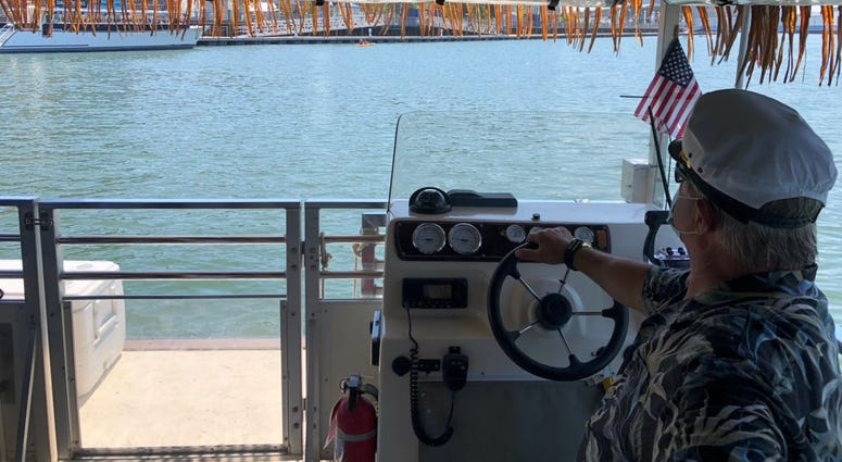 A maritime pilot on the Big Kahuna drives the boat along the Buffalo River. July 9, 2020 (WBEN Photo/Mike Baggerman)