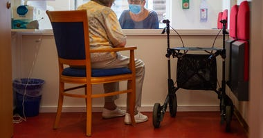 Nursing home visit/Getty Images