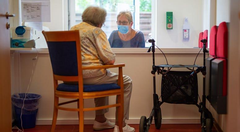 Nursing home visit/Getty Images