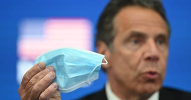 Governor Andrew Cuomo demonstrates a face mask