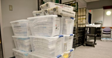 Mail-in ballots await counting