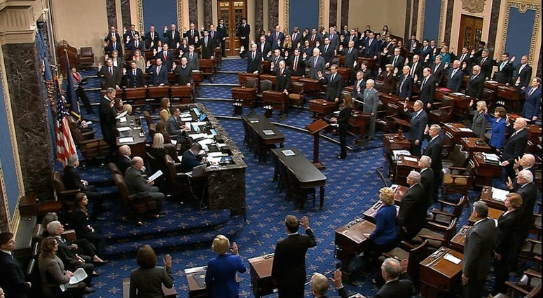 Supreme Court Chief Justice John Roberts swears in members of the Senate for the impeachment trial against President Donald Trump at the U.S. Capitol in Washington, Thursday, Jan. 16, 2020. (Senate Television via AP)