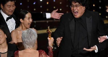 Bong Joon Ho is presented the award for Best Picture at the Oscars