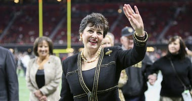 New Orleans Saints owner Gayle Benson waves to fans before a game