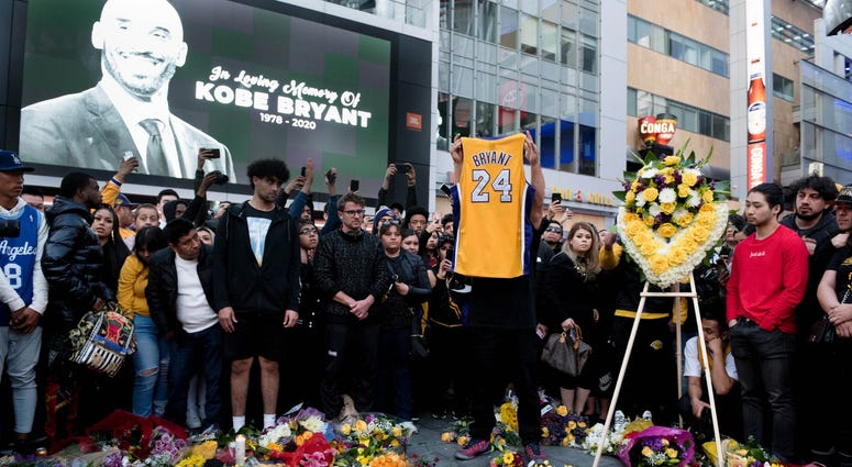 Fans gather at L.A. Live in Los Angeles to pay their respects to former Los Angeles Lakers guard Kobe Bryant who died in helicopter crash on Sunday