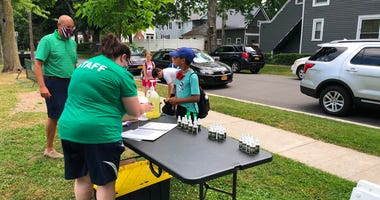 Kids sanitize their hands and undergo a temperature check before beginning summer youth camp in the Village of Hamburg. July 6, 2020 (WBEN Photo/Mike Baggerman)