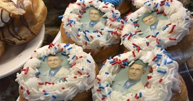 donuts bearing the likeness of Dr. Anthony Fauci, director of the National Institute of Allergy and Infectious Diseases, rest on a plate at Donuts Delite in Rochester, N.Y. Donuts Delite began making donuts featuring Fauci's face earlier in the week.