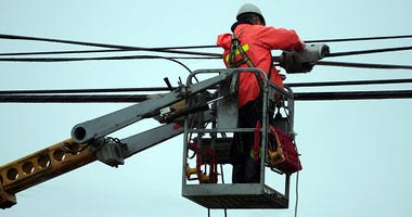 workers continue to make repairs on power lines in Northtowns