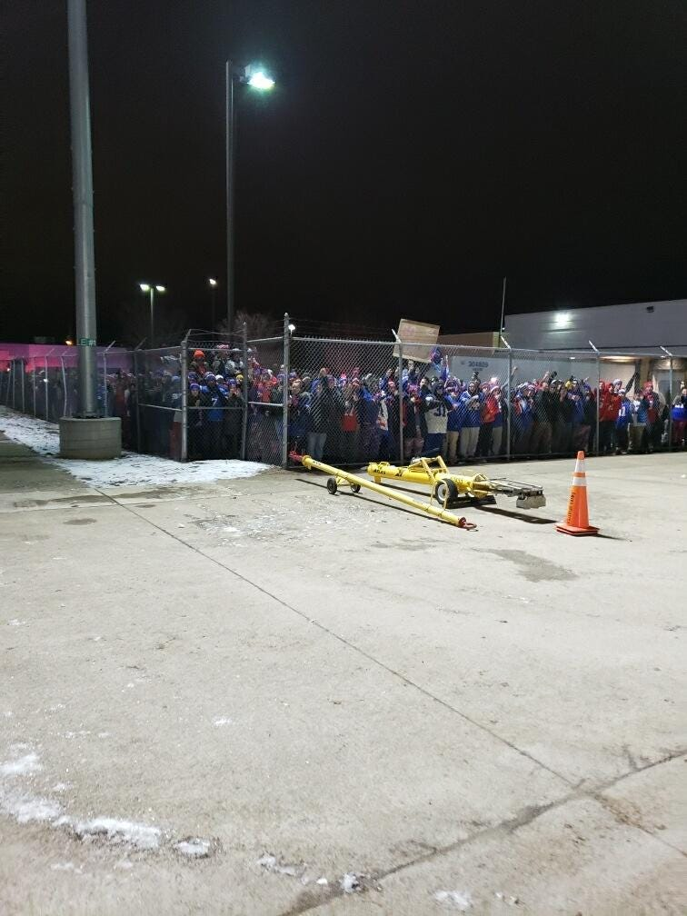 Buffalo Bills fans line fence at airport
