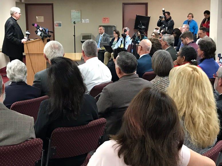 Media attends Bishop Scharfenberger press conference