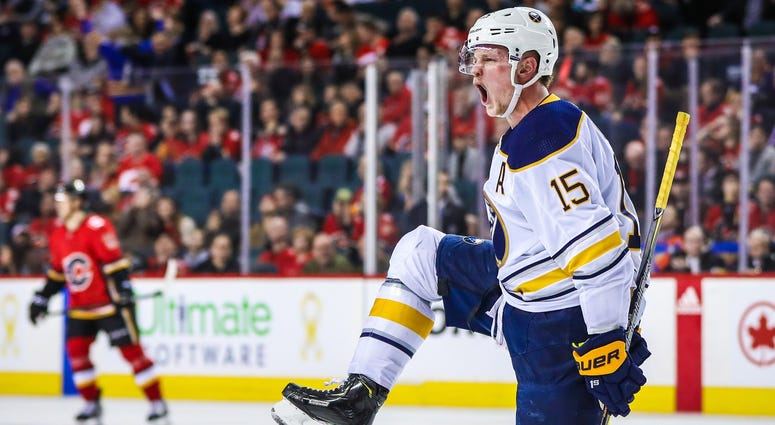 Jan 22, 2018; Calgary, Alberta, CAN; Buffalo Sabres center Jack Eichel (15) celebrates his goal against the Calgary Flames during the overtime period at Scotiabank Saddledome. Buffalo Sabres won 2-1.