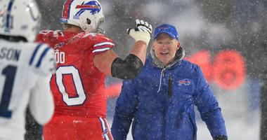 Dec 10, 2017; Orchard Park, NY, USA; Buffalo Bills head coach Sean McDermott celebrates on the field with center Eric Wood (70) following their overtime win against the Indianapolis Colts at New Era Field.