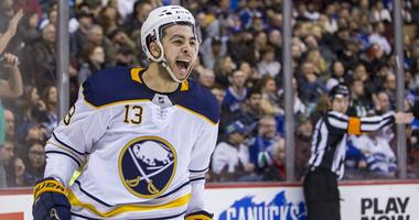 Jan 25, 2018; Vancouver, British Columbia, CAN; Buffalo Sabres right wing Nicholas Baptiste (13) celebrates his goal against the Vancouver Canucks during the second period at Rogers Arena.