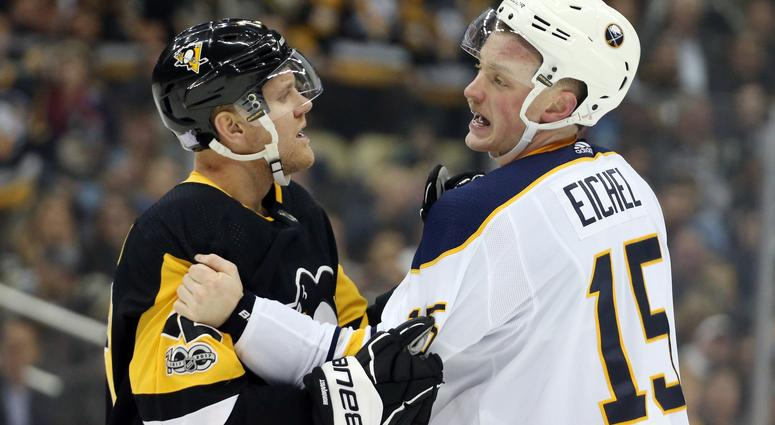 Nov 14, 2017; Pittsburgh, PA, USA; Pittsburgh Penguins right wing Patric Hornqvist (72) restrains Buffalo Sabres center Jack Eichel (15) during the first period at PPG PAINTS Arena.
