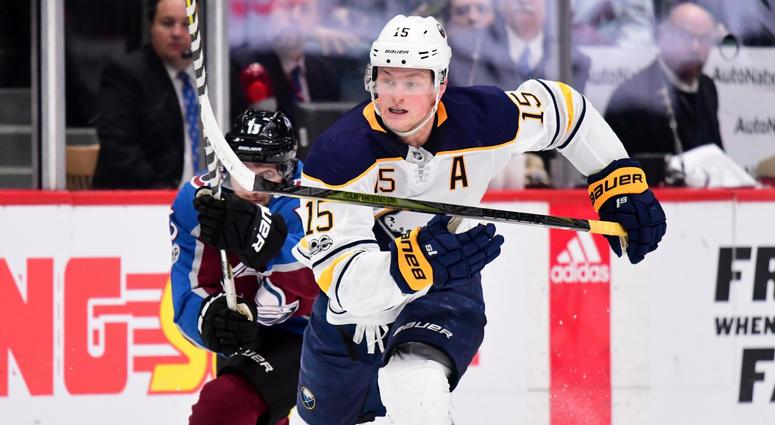Dec 5, 2017; Denver, CO, USA; Buffalo Sabres center Jack Eichel (15) shoots and scores an empty net goal as Colorado Avalanche center Alexander Kerfoot (13) chases down from behind in the third period at the Pepsi Center.