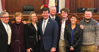 Erie County Executive Mark Poloncarz poses with family members and Justice Gerald J. Whalen after his inauguration as Erie County Executive. December 31, 2019 (WBEN Photo/Mike Baggerman)