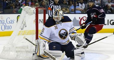 Oct 25, 2017; Columbus, OH, USA; Buffalo Sabres goalie Chad Johnson (31) makes a save against the Columbus Blue Jackets during the second period at Nationwide Arena.
