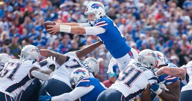 Buffalo Bills quarterback Josh Allen (17) reaches the ball across the goal line to score a touchdown against the New England Patriots in the third quarter at New Era Field. Mark Konezny-USA TODAY Sports