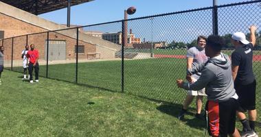 Students play football outside Bennett High School. August 9, 2018 (WBEN Photo/Mike Baggerman)