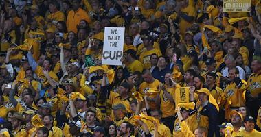 Jun 5, 2017; Nashville, TN, USA; Nashville Predators fans cheer and hold signs for the Stanley Cup in game four of the 2017 Stanley Cup Final at Bridgestone Arena.