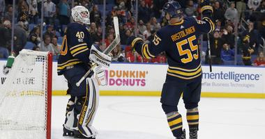 Oct 24, 2017; Buffalo, NY, USA; Buffalo Sabres goalie Robin Lehner (40) celebrates his shutout win with defenseman Rasmus Ristolainen (55) during the third period against the Detroit Red Wings at KeyBank Center. Buffalo beats Detroit 1 to 0.