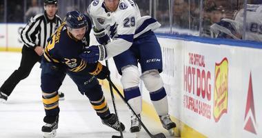 Nov 28, 2017; Buffalo, NY, USA; Buffalo Sabres center Sam Reinhart (23) and Tampa Bay Lightning defenseman Slater Koekkoek (29) go after a loose puck during the first period at KeyBank Center.