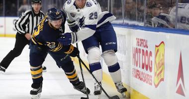 Nov 28, 2017; Buffalo, NY, USA; Buffalo Sabres center Sam Reinhart (23) and Tampa Bay Lightning defenseman Slater Koekkoek (29) go after a loose puck during the first period at KeyBank Center.