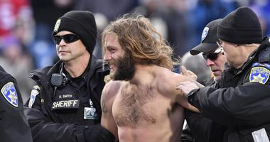 Nov 12, 2017; Orchard Park, NY, USA; Buffalo police remove a streaker from the field during the fourth quarter a game against the New Orleans Saints at New Era Field.