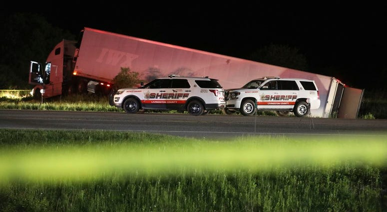 Livingston County Sheriff's work at the scene of cab of a tractor trailer after the driver was killed during a shootout with law enforcement officers
