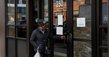 Visitors are unable to gain access to the Department of Labor due to closures over coronavirus concerns, Wednesday, March 18, 2020, in New York.