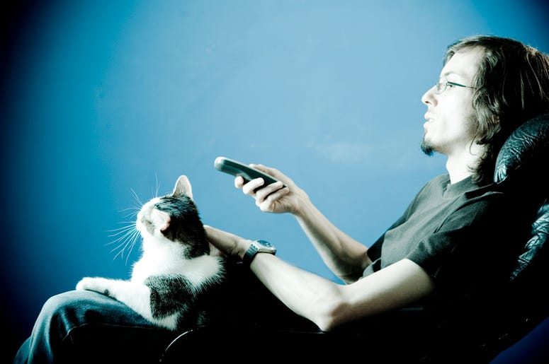 Man Binge Watching TV with a Cat