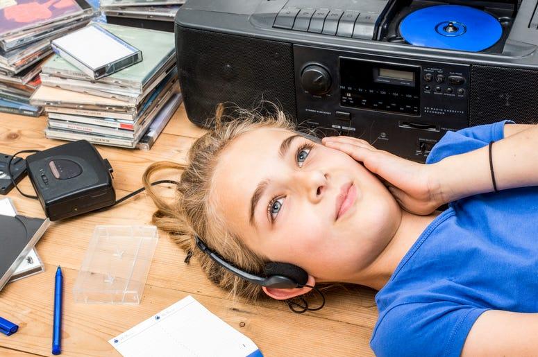 Girl Listening to CDs