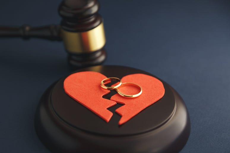 Broken heart and wedding rings with a judge's gavel