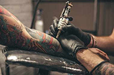 Person getting tattooed