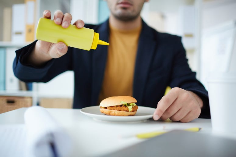 Man pouring out mustard