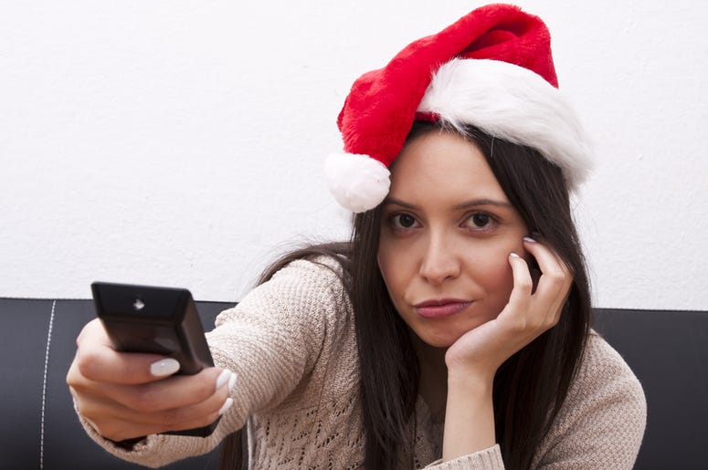 woman in santa hat with remote