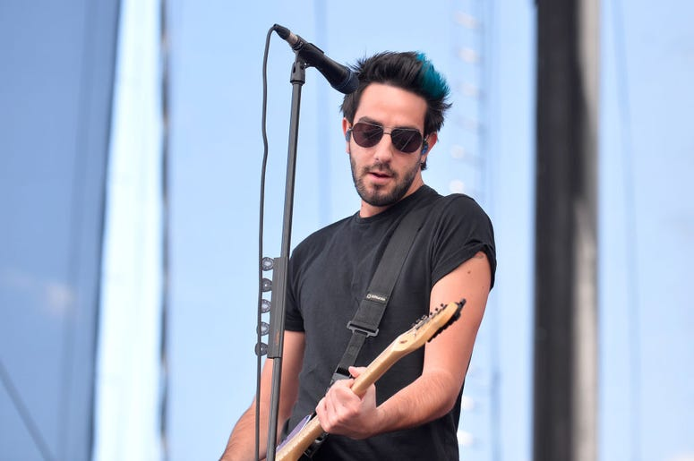 Jack Barakat of All Time Low performs onstage during the Daytime Village Presented by Capital One at the 2017 HeartRadio Music Festival at the Las Vegas Village on September 23, 2017 in Las Vegas, Nevada