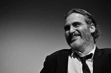 Smiling Joaquin Phoenix