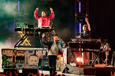 Musicians from Linkin Park; Brad Delsen, Mike Shinoda and Joe Hahn perform