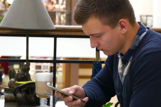 Man Scrolling Through Phone