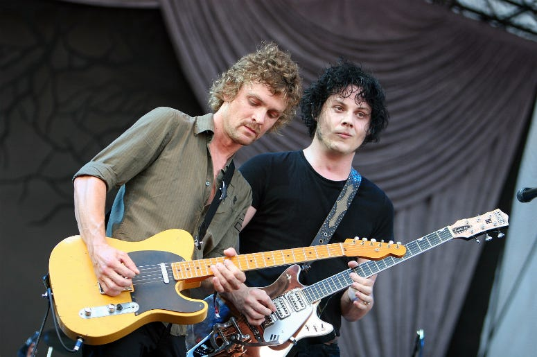 Singer/guitarist Brendan Benson (L) and singer/guitarist Jack White of The Raconteurs perform onstage at the 2008 Lollapalooza