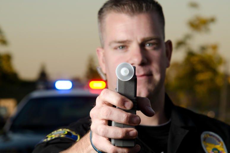 Cop with a breathalyzer