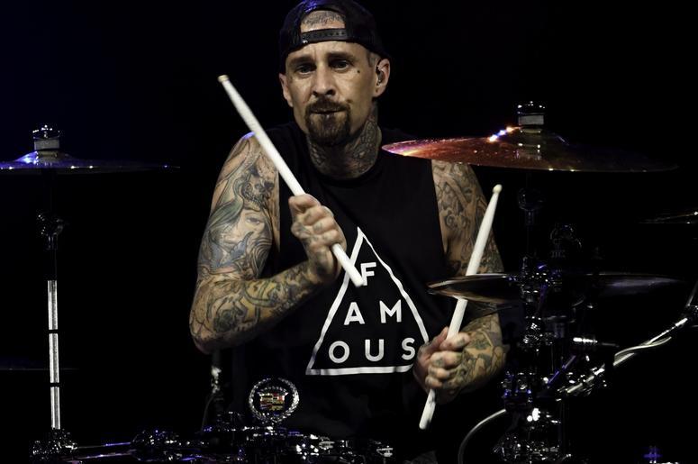 Blink-182 drummer Travis Barker performs at Perfect Vodka Amphitheater