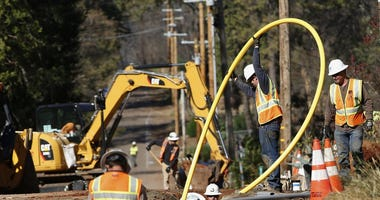 Pacific Gas and Electric Company, workers bury utility lines in Paradise, Calif.