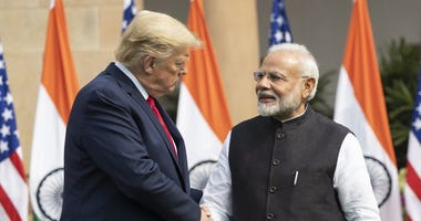 President Donald Trump and Indian Prime Minister Narendra Modi shake hands before their meeting at Hyderabad House, Tuesday, Feb. 25, 2020, in New Delhi, India.