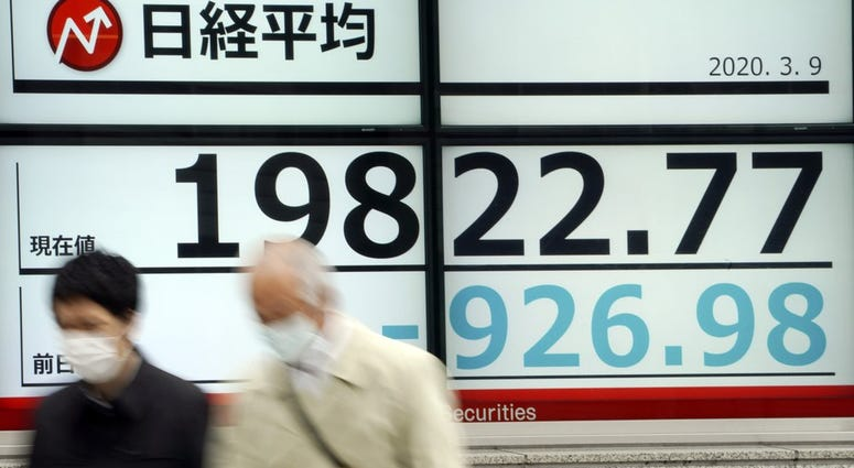 Asian stock markets plunged Monday after global oil prices nosedived on worries a global economy weakened by a virus outbreak might be awash in too much crude.