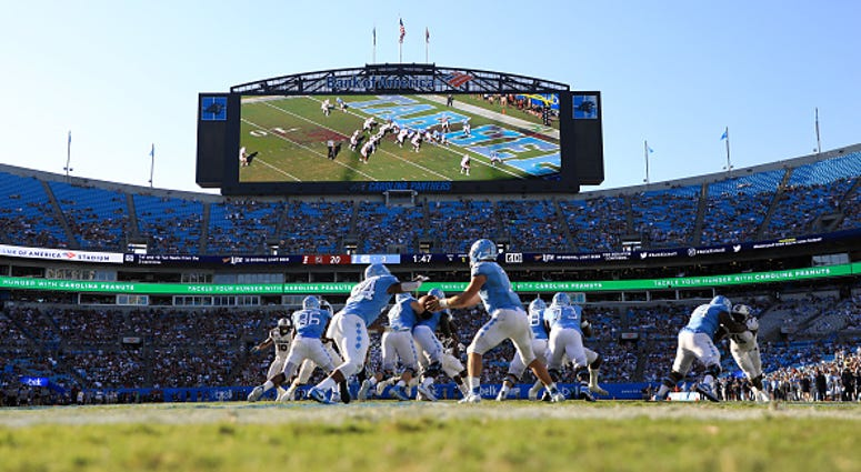 CHARLOTTE, NORTH CAROLINA - AUGUST 31: Sam Howell #7 of the North Carolina Tar Heels hands the ball off to teammate Antonio Williams #24 of the North Carolina Tar Heels during the Belk College Kickoff game at Bank of America Stadium on August 31, 2019 in