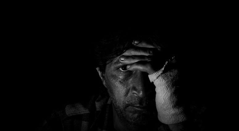 Man sitting alone in dark room