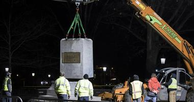 The school's board of governors violated the state's open meetings laws by secretly negotiating and approving a deal to dispose of the Confederate monument from the campus of the system's flagship school, according to a lawsuit.
